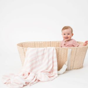 Baby using eco-friendly love and lee pink bamboo blanket