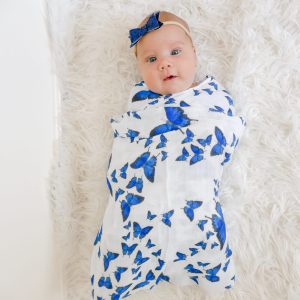 A baby wrap by an eco-friendly blue flutterby butterfly swaddle