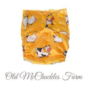 Chuckles reusable cloth pocket AI2 nappy kiwiana yellow cow sheep