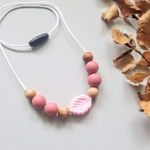 food grade silicone, beech wood on satin cord with a safety clasp.