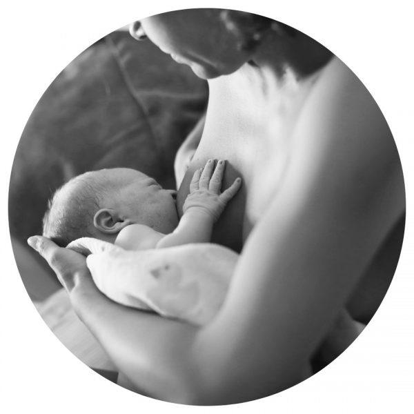 woman breastfeeding newborn